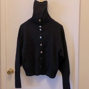 Women's Black sweater.
